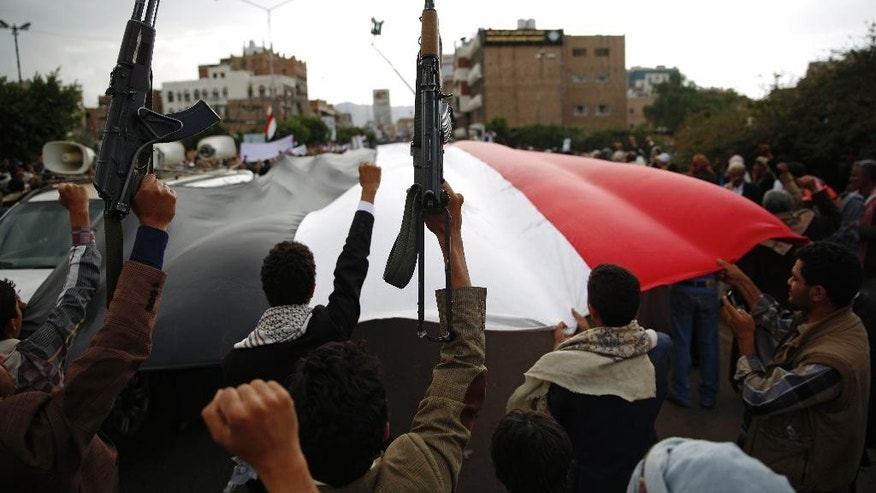 Shiite rebels known as Houthis hold up their weapons as they chant slogans during a rally to protest Saudi-led airstrikes, in Sanaa, Yemen, Monday, Aug. 24, 2015. The Saudi-led coalition fighting Shiite rebels in Yemen doubled its near-daily airstrikes in the central province of Marib and the adjacent border area of Jawf on Monday, paving the way for allies on the ground to push north toward Shiite rebel strongholds, military and security officials said. (AP Photo/Hani Mohammed)