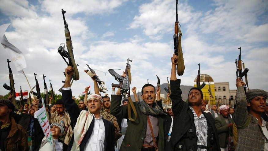 Shiite rebels known as Houthis hold up their weapons as they chant slogans during a rally against Saudi-led airstrikes in Sanaa, Yemen, Monday, Aug. 24, 2015. (AP Photo/Hani Mohammed)