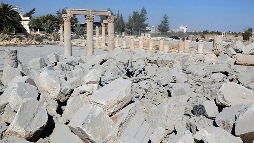 FILE - This undated file photo released Tuesday, Aug. 25, 2015 on a social media site used by Islamic State militants, which has been verified and is consistent with other AP reporting, shows the demolished 2,000-year-old temple of Baalshamin in Syria's ancient caravan city of Palmyra. The nearly 2,000-year-old temple in the Syrian city of Palmyra this week was the latest victim in the Islamic State group's campaign of destruction of historic sites across the territory it controls in Iraq and Syria. (Islamic State social media account via AP)