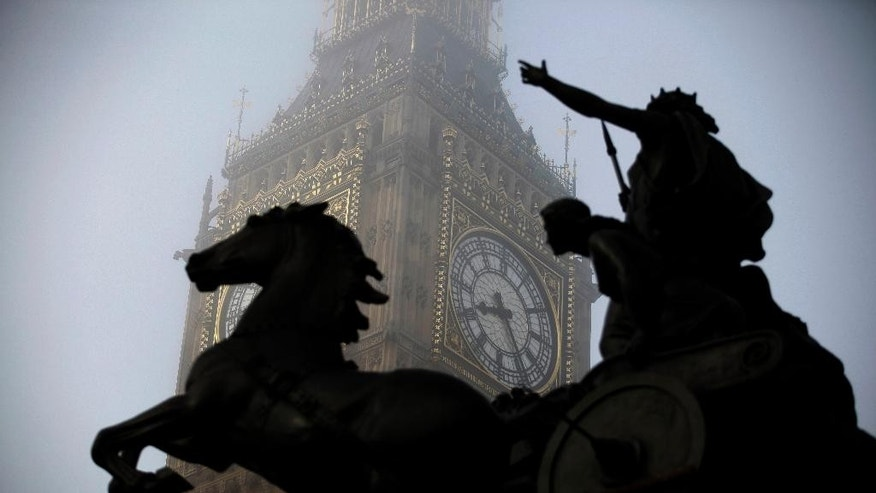 FILE - In this Thursday, March 15, 2012 file photo, the Boudica statue stands in the foreground as fog shrouds the clock tower which houses the Big Ben bell at the Palace of Westminster, London. Officials on Tuesday, Aug. 25, 2015 said that the famous clock at Britain's Parliament, used by people across Britain to check the time, has recently been slow by as much as six seconds. (AP Photo/Matt Dunham, File)