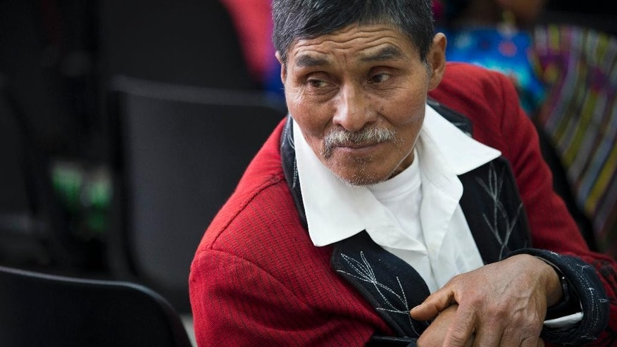 Ixil indigenous Miguel Raymundo attends the genocide trial of Guatemala's former dictator Jose Efrain Rios Montt in in Guatemala City, Tuesday, Aug. 25, 2015. A Guatemalan court ruling announced Tuesday that Rios Montt can stand trial but in a special proceeding because the 89-year-old suffers from dementia. The court says the law allows for a special trial where all evidence and witnesses will be presented behind closed doors with a representative. He can be found innocent or guilty, but will not receive a sentence because of his health conditions. (AP Photo/Moises Castillo)