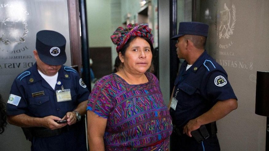 An Ixil woman enters the court room during the genocide trial of Guatemala's former dictator Jose Efrain Rios Montt in in Guatemala City, Tuesday, Aug. 25, 2015. A Guatemalan court ruling announced Tuesday that Rios Montt can stand trial but in a special proceeding because the 89-year-old suffers from dementia. The court says the law allows for a special trial where all evidence and witnesses will be presented behind closed doors with a representative. He can be found innocent or guilty, but will not receive a sentence because of his health conditions. (AP Photo/Moises Castillo)