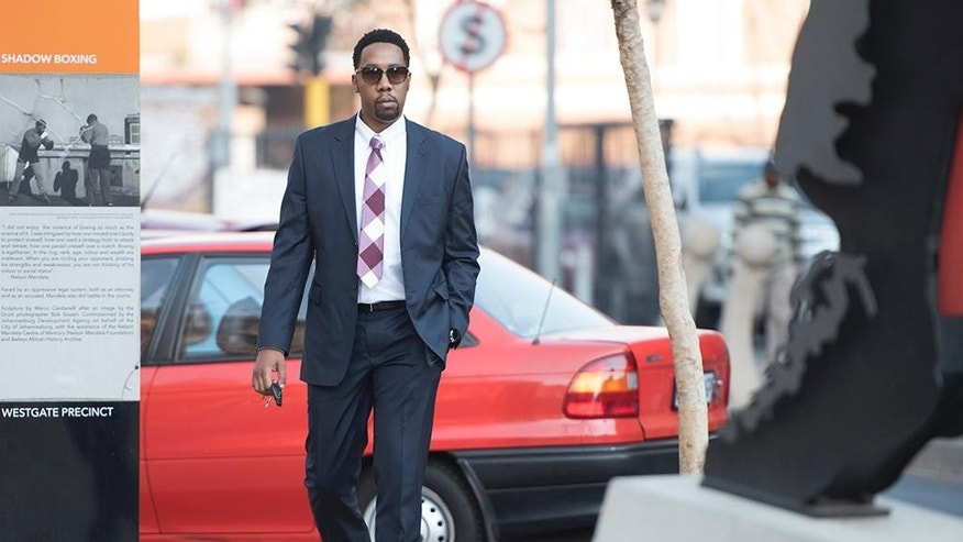 Ndaba Mandela arrives at the Johannesburg Magistrates Court, Tuesday, Aug. 25, 2015 in support of a 25-year-old grandson of former president Nelson Mandela who is accused of raping a minor at a Johannesburg bar. (AP Photo/Shiraaz Mohamed)