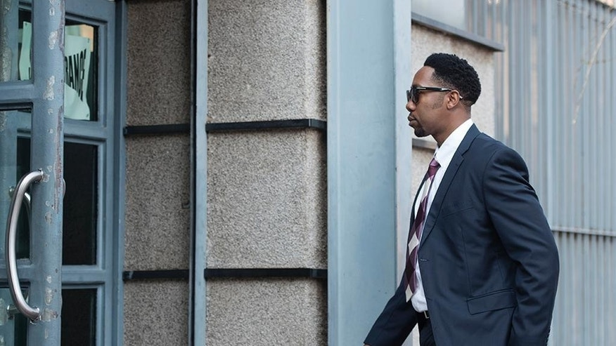 Ndaba Mandela arrives at the Johannesburg Magistrates Court, Tuesday, Aug. 25, 2015 in support of a 25-year-old grandson of the former statesman who is accused of raping a minor at a Johannesburg bar. (AP Photo/Shiraaz Mohamed)