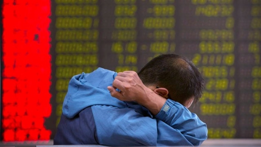 Aug. 25, 2015: A Chinese investor monitors stock prices at a brokerage house in Beijing. (AP Photo/Mark Schiefelbein)