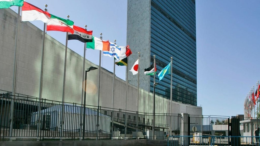 FFILE - In this Sept. 18, 2007 file photo, the flags of member nations fly outside of the United Nations headquarters. In a move likely to upset Israel's government, the Palestinians and the Vatican are seeking to raise their flags at the U.N., just in time for Pope Francis' visit in September 2015. (AP Photo/Mary Altaffer, File)