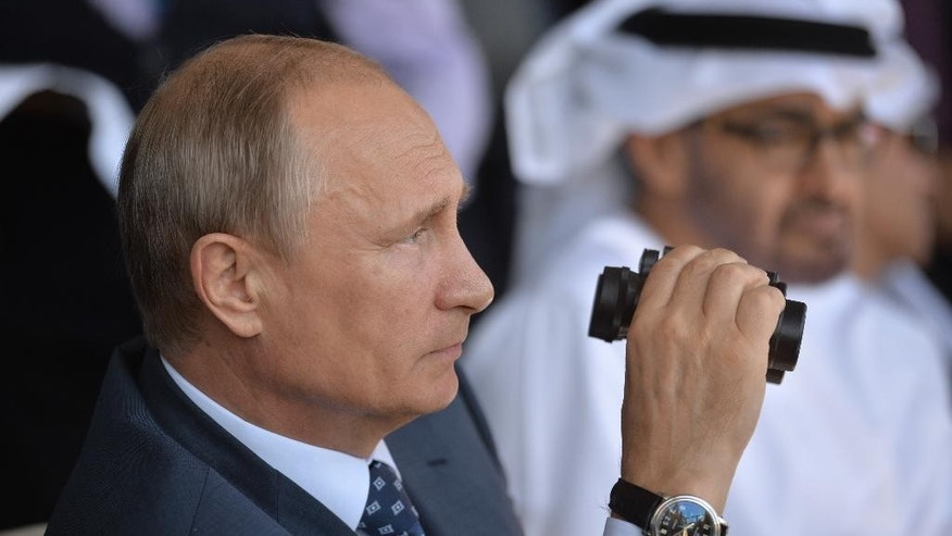 Russian President Vladimir Putin watches the opening ceremony of the MAKS-2015 (the International Aviation and Space Show) in Zhukovsky, outside Moscow, Russia, on Tuesday, Aug. 25, 2015. (Alexei Druzhinin/RIA Novosti, Kremlin Pool Photo via AP)