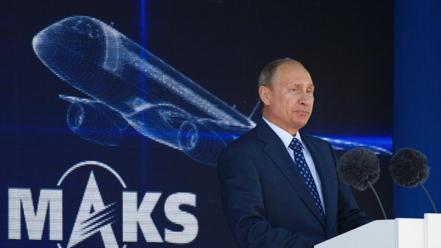 Russian President Vladimir Putin speaks at the opening ceremony of the MAKS-2015 (the International Aviation and Space Show) in Zhukovsky, outside Moscow, Russia, on Tuesday, Aug. 25, 2015. (AP Photo/Ivan Sekretarev)