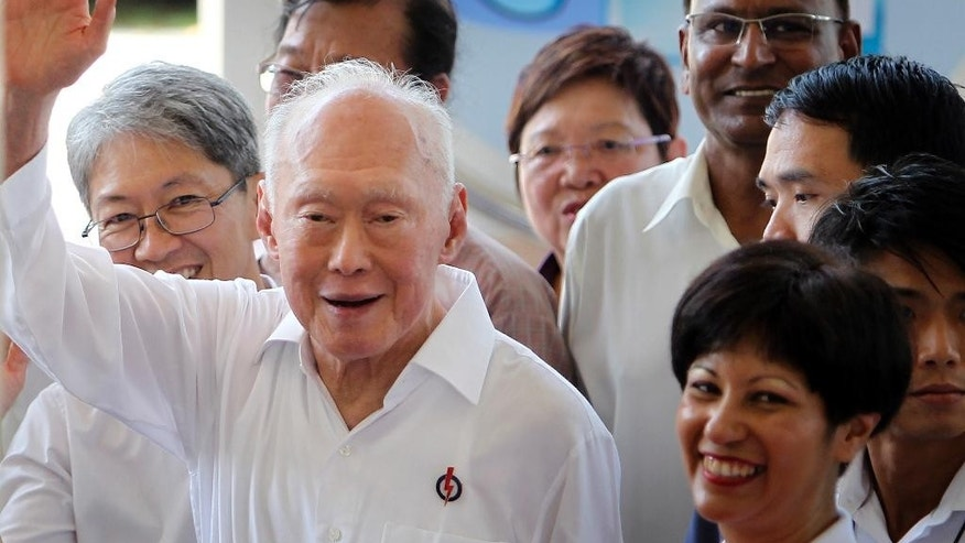 FILE - In this April 27, 2011 file photo, then Singapore's Minister Mentor Lee Kuan Yew waves to supporters as he arrives at an elections nomination center, in Singapore.  Singapore will hold a general election on Sept. 11, 2015,  the government announced Tuesday, Aug. 25, 2015,  in what is expected to be a tight contest for the ruling party that has dominated politics in the city-state for 50 years but is now facing growing disaffection among citizens. (AP Photo/Wong Maye-E, File)