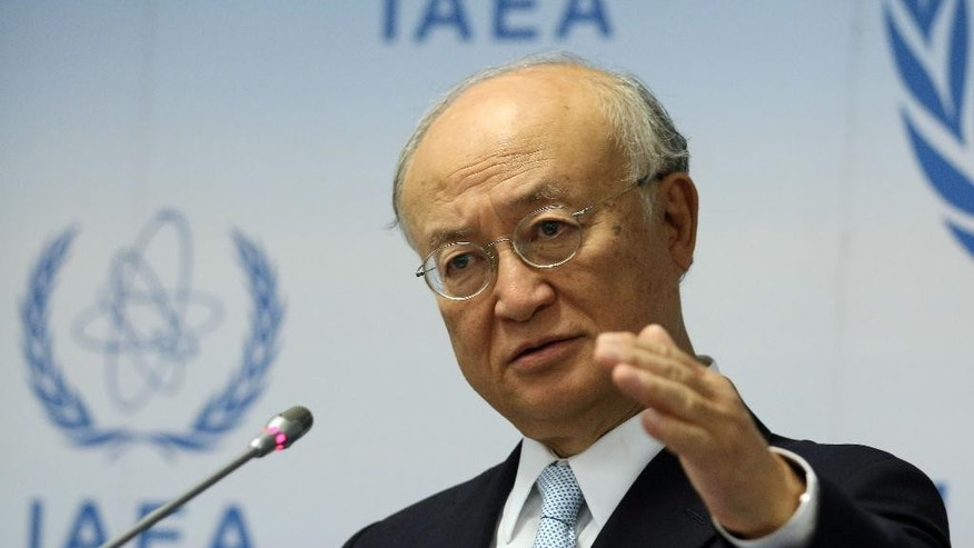 Director General of the International Atomic Energy Agency, IAEA, Yukiya Amano of Japan addresses the media during a news conference after a meeting of the IAEA board of governors at the International Center in Vienna, Austria, Tuesday Aug. 25, 2015. (AP Photo/Ronald Zak)