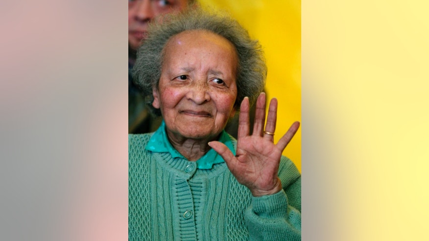 FILE - In this Monday, Dec. 12, 2011 file photo, Belgian nurse Augusta Chiwy gestures after receiving an award for valor from the U.S. Army, in Brussels. Chiwy who helped save hundreds of American soldiers during the Battle of the Bulge at the end of World War II has died, she was 94. A service of burial will be held in the town of Bastogne, southeast Belgium on Saturday, Aug. 29, 2015. (AP Photo/Yves Logghe, File)