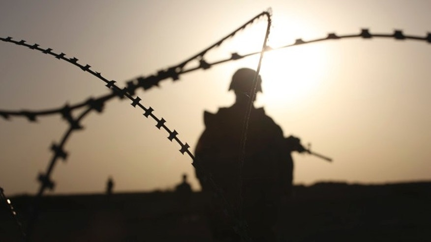 FILE 2009: U.S. Marines patrol the Nawa district, Helmand province, southern Afghanistan