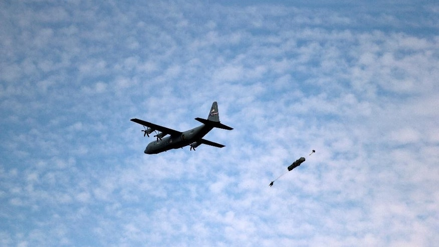 A US paratrooper with the 18th Airborne Corps jumps out of an airplane during Swift Response 15 air exercise, the largest airborne training event in Europe since the end of the Cold War, at the Smardan training range in eastern Romania, Wednesday, Aug. 26, 2015. More than 200 paratroopers from Italy, Spain, and the U.S. have taken part in a parachute assault at a shooting range in eastern Romania, part of a month of exercises to demonstrate NATO's capacity to rapidly deploy and operate. (AP Photo/Vadim Ghirda)