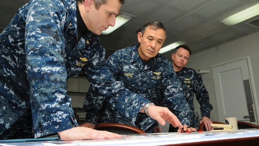 FILE 2011: Defense Secretary Voltaire Gazmin said the commander, Adm. Harry Harris Jr., center, assured him of U.S. readiness to provide assistance.