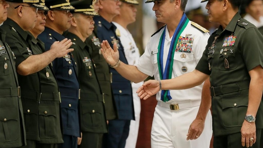 "U.S. Navy Admiral Harry B Harris, second from right, United States Pacific Command to the Philippines Commander (USPACOM), is introduced to major service commanders of the Armed Forces of the Philippines by armed forces chief Gen. Hernando Iriberri, right, following welcoming ceremony at the armed forces headquarters at suburban Quezon city northeast of Manila, Philippines Wednesday, Aug. 26, 2015. In the Armed Forces of the Philippines press statement, Admiral Harris is here for a two-day ""to discuss bilateral security concerns with the Philippines and gain local perspective on the security situation in the area of the Pacific region where the Philippines is located."" (AP Photo/Bullit Marquez)"