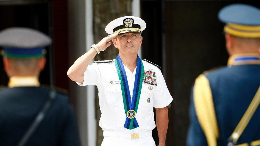 "U.S. Navy Admiral Harry B Harris salutes during welcoming ceremony at the armed forces headquarters at suburban Quezon city, northeast of Manila, Philippines Wednesday, Aug. 26, 2015. In the Armed Forces of the Philippines press statement, Admiral Harris is here for a two-day visit ""to discuss bilateral security concerns with the Philippines and gain local perspective on the security situation in the area of the Pacific region where the Philippines is located."" (AP Photo/Bullit Marquez)"