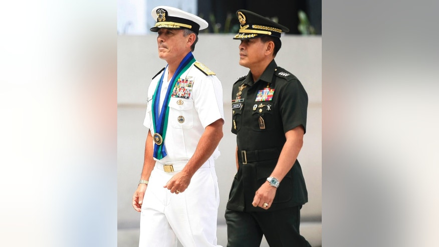"U.S. Navy Admiral Harry B Harris, left, United States Pacific Command to the Philippines Commander (USPACOM), is escorted by Philippine Armed Forces Chief Gen. Hernando Iriberri for a welcoming ceremony at the armed forces headquarters at suburban Quezon city northeast of Manila, Philippines Wednesday, Aug. 26, 2015. In the Armed Forces of the Philippines press statement, Admiral Harris is here for a two-day visit ""to discuss bilateral security concerns with the Philippines and gain local perspective on the security situation in the area of the Pacific region where the Philippines is located."" (AP Photo/Bullit Marquez)"