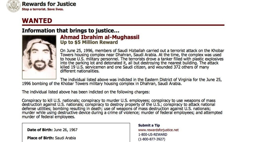 This wanted poster from website of the U.S. State Department's Rewards For Justice program shows a mugshot of Ahmed al-Mughassil, the man suspected in the 1996 bombing of the Khobar Towers residence at a U.S. military base in Saudi Arabia. A U.S. official told the Associated Press on Wednesday, Aug. 26, 2015 that al-Mughassil has been captured. (U.S. State Department Rewards For Justice via AP)