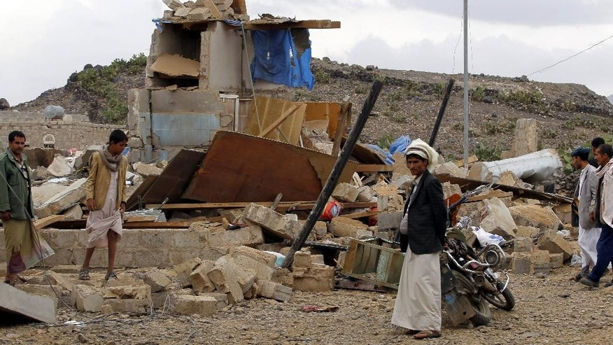 Yemeni people inspect a house destroyed by a Saudi airstrike in Sanaa, Yemen, Wednesday, Aug. 26, 2015. (AP Photo/Hani Mohammed)