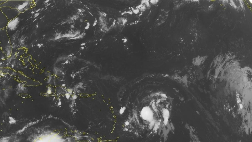This NOAA satellite image taken Wednesday, Aug. 26, 2015, at 12:45 a.m. EDT shows an area of thunderstorms around Hispaniola associated with the remnants of the former Hurricane Danny. to the east of the Lesser Antilles is Tropical Storm Erika which is currently packing maximum sustained winds of 40 miles per hour. It is forecast to further strengthen as it moves to the west-northwest over the coming days. (Weather Underground via AP)