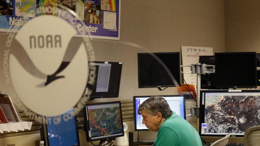 Jack Beven, senior hurricane specialist, tracks the movement of Tropical Storm Erika as it moves westward towards islands in the eastern Caribbean, at the National Hurricane Center, Wednesday, Aug. 26, 2015, in Miami. Tropical storm warnings have been issued for Puerto Rico, the U.S. and British Virgin Islands, and the Leeward islands. (AP Photo/Lynne Sladky)