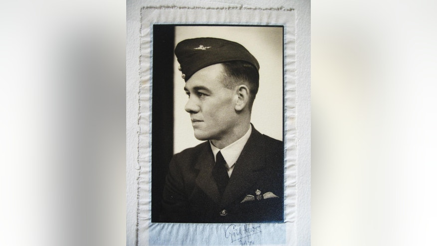 This undated photo provided by Gordon Royle shows a photograph of his father Paul Royle in uniform during World War ll. Paul Royle, an Australian pilot who took part in a mass breakout from a German prisoner of war camp during World War II that is remembered as The Great Escape, has died in his hometown of Perth, his son said Friday, Aug. 28, 2015. He was 101.(Gordon Royle via AP)