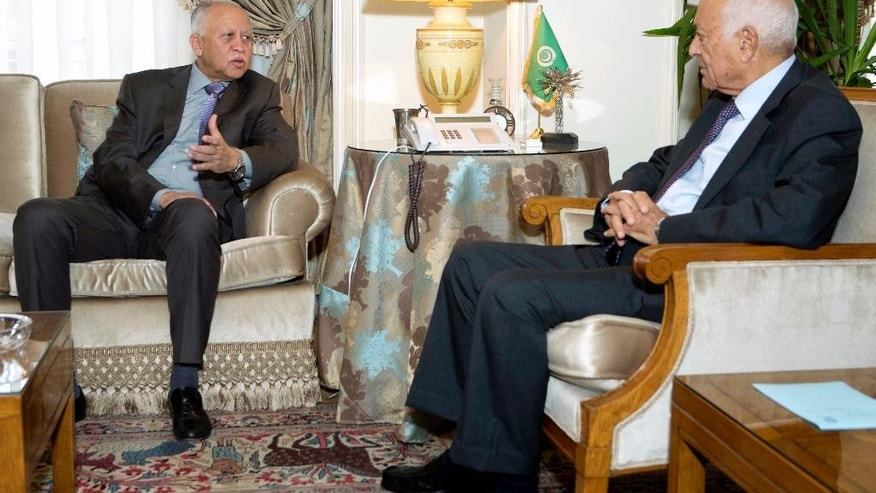 Arab League's Secretary-General Nabil Elaraby, right, meets with Yemeni Foreign Minister Yassin Riad at the Arab League headquarters in Cairo, Egypt, Thursday, Aug. 27, 2015. (AP Photo/Amr Nabil)