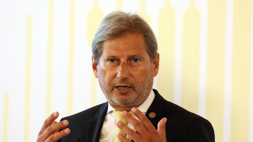 European Neighborhood Policy & Enlargement Negotiations commissioner Johannes Hahn addreses s the media during the Western Balkans Summit at the Hofburg palace in Vienna, Austria, Thursday, Aug 27, 2015. (AP Photo/Ronald Zak)