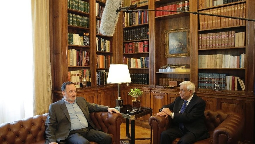 Former Energy Minister and head a party called Popular Unity, Panagiotis Lafazanis, left , speaks with Greek President Prokopis Pavlopoulos, during their meeting in Athens, Thursday, Aug. 27, 2015. Greece came one step closer to early elections Thursday as Lafazanis the head of a new breakaway left-wing party returned his mandate to form a government to the country's president after having failed to find willing coalition partners.(AP Photo/Petros Giannakouris)