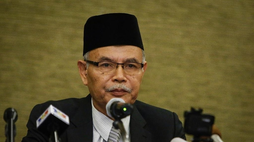 Patani Consultative Council chairman Awang Jabat speaks at a press conference in Kuala Lumpur, Malaysia, Thursday, Aug. 27, 2015. Muslim militant leaders in peace talks with Thai authorities to end a deadly insurgency said Thursday they are seeking an independent Islamic state in Thailand's three southernmost provinces. Awang Jabat said the coalition wants the peace talks to be put on the national agenda to ensure continuity if a new government comes into power. The peace effort must be able to continue from where it stops, rather than having to start afresh again if the government changes, he said. (AP Photo/Joshua Paul)