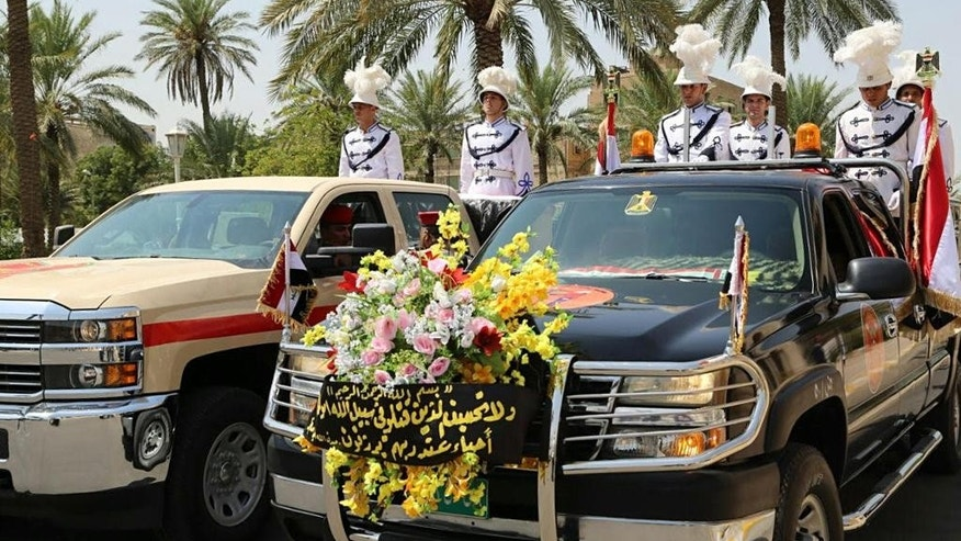 Iraqi honor guards escort the coffins of Maj. Gen. Abdul-Rahman Abu-Regheef, deputy chief of operations in Anbar and Brig. Gen. Sefeen Abdul-Maguid, commander of the 10th Army Division who was killed in Ramadi during fighting with Islamic State militants, during the funeral procession at the headquarters of the Iraqi Ministry of Defense in Baghdad, Iraq, Thursday, Aug. 27, 2015. An Islamic State suicide bomber killed two Iraqi army generals on Thursday as they led forces against IS positions in the turbulent Anbar province west of Baghdad, military officials said. (AP Photo)