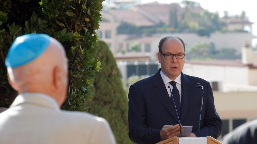 Prince Albert II delivers his speech before unveiling a monument to Jews deported from the Riviera principality during World War II, as part of a larger effort to shed light at last on a troubling chapter in the country's history, in a cemetery in Monaco, Thursday, Aug. 27, 2015. Prince Albert II presented the monument Thursday, marking 73 years since Monegasque authorities under Nazi occupation rounded up several Jews on the night of Aug. 27-28, 1942. (AP Photo/Claude Paris)