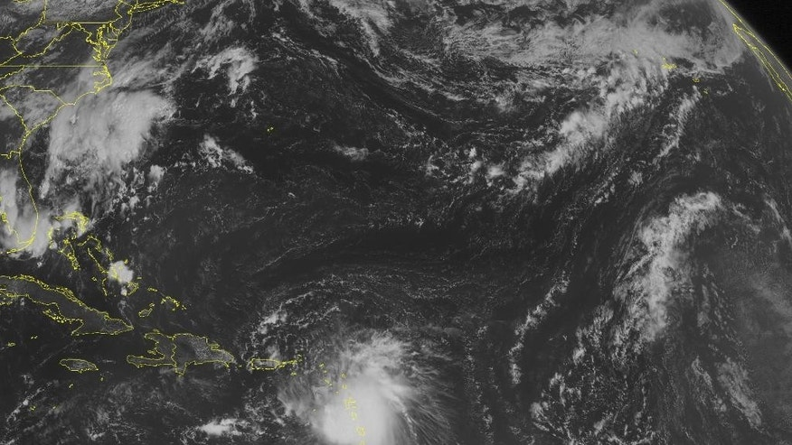 This NOAA satellite image taken Thursday, August 27, 2015 at 09:45 AM EDT shows Tropical Storms Erika moving westward through the Lesser Antilles. Erika is packing sustained winds of 45 miles an hour and is expected to slowly strengthen as it moves close to Puerto Rico and Hispaniola. Heavy rains and strong winds will be accompanying Erika. Mainly quiet weather is dominating the rest of the Caribbean. (AP PHOTO/WEATHER UNDERGROUND)
