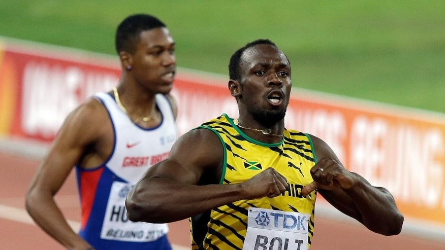 Jamaica's Usain Bolt celebrates after winning the gold in the men's 200m final at the World Athletics Championships at the Bird's Nest stadium in Beijing, Thursday, Aug. 27, 2015. (AP Photo/Darron Cummings)