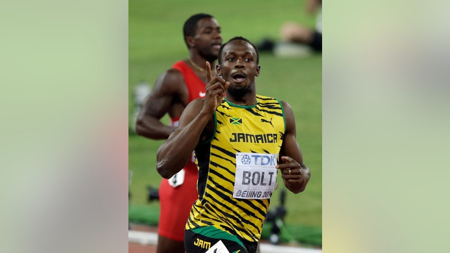 297Jamaica's Usain Bolt celebrates after winning the gold in the men's 200m final at the World Athletics Championships at the Bird's Nest stadium in Beijing, Thursday, Aug. 27, 2015. (AP Photo/Darron Cummings)