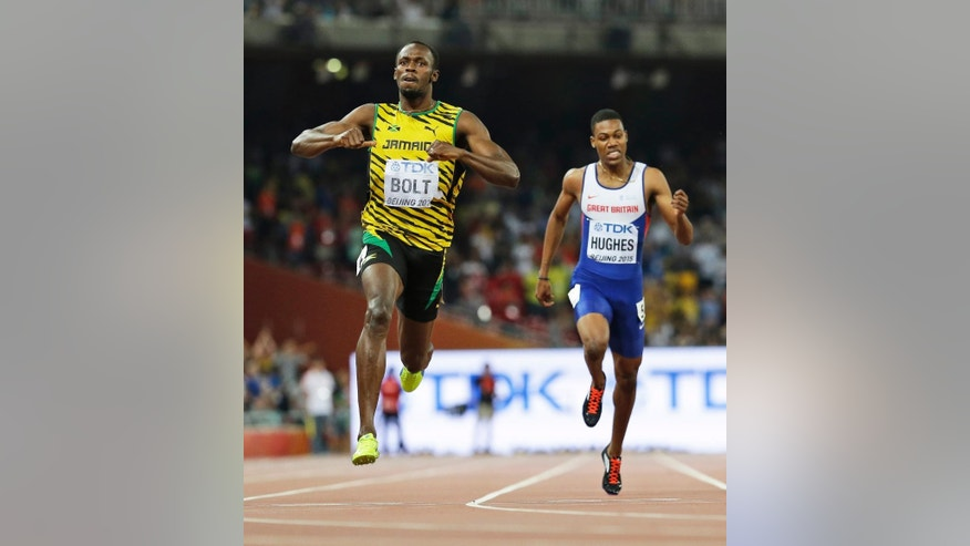 Jamaica's Usain Bolt celebrates after winning the men's 200m final at the World Athletics Championships at the Bird's Nest stadium in Beijing, Thursday, Aug. 27, 2015. Britain's Zharnel Hughes is at right. (AP Photo/David J. Phillip)