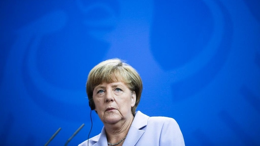 German Chancellor Angela Merkel attends a news conference with Danish Prime Minister Lars Loekke Rasmussen after talks at the chancellery in Berlin, Friday, Aug. 28, 2015. (AP Photo/Markus Schreiber).