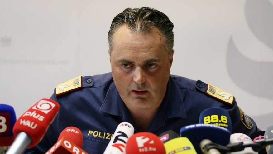 Police Director of the Austrian province of Burgenland Hans Peter Doskozil informs the media at  a news conference  at a police station in Eisenstadt, Austria, Thursday, Aug 27, 2015. Austrian police on Thursday discovered the badly decomposing bodies of at least 20 — and possibly up to 50 — migrants stacked in a truck parked on the shoulder of the main highway from Budapest to Vienna .  (AP Photo/Ronald Zak)