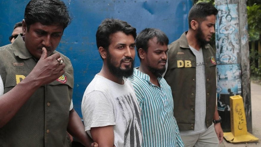 Suspected Muslim militants Kausar Hossain Khan, 29, second from right, and Kamal Hossain Sardar, 29, second from left, who were arrested in the killing of a secular blogger, are escorted to appear before the media in Dhaka, Bangladesh, Friday, Aug. 28, 2015. Police in Bangladesh have arrested two more suspected members of a banned militant group thought to be behind the slaying of the secular blogger in the fourth such deadly attack this year. (AP Photo/A.M. Ahad)