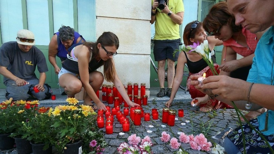 Aug 27, 2015: People light candles in Austria after police on Thursday discovered the badly decomposing bodies of 71 migrants.