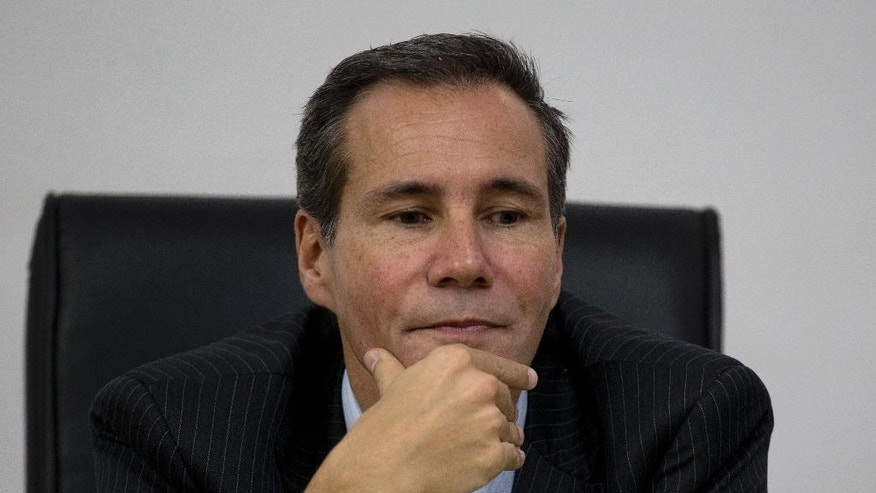 FILE - In this May 29, 2013, file photo, Alberto Nisman, the prosecutor investigating the 1994 bombing of the Argentine-Israeli Mutual Association community center, talks to journalists in Buenos Aires, Argentina. It was announced on Friday, Aug. 28, 2015, that an Argentine judge is approving a money laundering probe involving Nisman, who died mysteriously while investigating the bombing of a Jewish center. (AP Photo/Natacha Pisarenko, File)