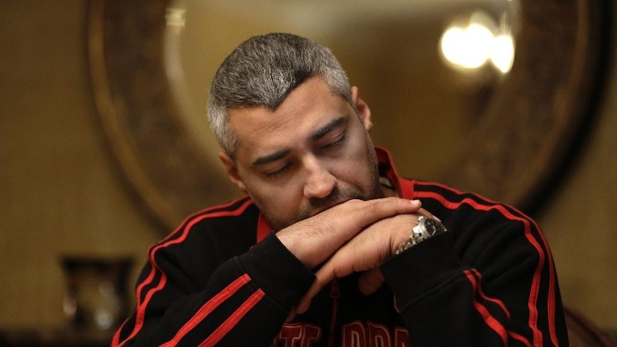 FILE- In this Feb. 19, 2015, file photo, Canadian Al-Jazeera English journalist Mohamed Fahmy, pauses during an interview with The Associated Press in Cairo, Egypt. An Egyptian court on Saturday, Aug. 29, 2015, sentenced three Al-Jazeera English journalists, including Fahmy, to three years in prison, ending a long-running trial criticized worldwide by press freedom advocates and human rights activists. (AP Photo/Hassan Ammar, File)