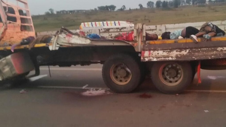 Dead bodies lay on the back of a truck Saturday Aug. 29, 2015 near Swaziland's capital Mbabane after tens  of girls and young women were killed in a crash while traveling to a famous traditional festival Friday. The truck they were traveling in collided with another vehicle the Swaziland Solidarity Network said in a statement. (AP Photo)