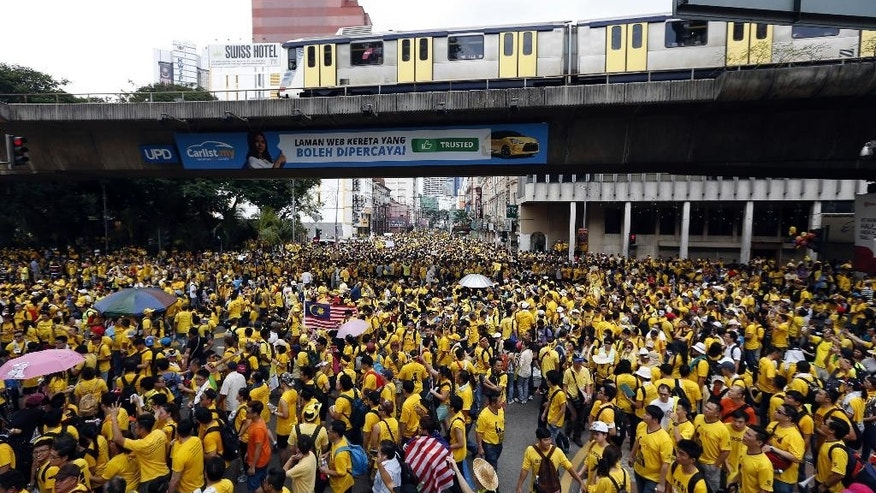 """Protesters march at a rally organized by pro-democracy group """"Bersih"""" (Clean) in Kuala Lumpur, Malaysia, Saturday, Aug. 29, 2015. Malaysian activists are putting more pressure on embattled Prime Minister Najib Razak to resign with major street rallies this weekend following allegations of suspicious money transfers into his accounts. (AP Photo/Lai Seng Sin)"""