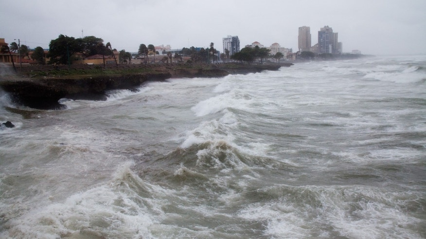 Strong winds and waves batter the coast of  Santo Domingo, in the D.R., Friday, August 28, 2015.