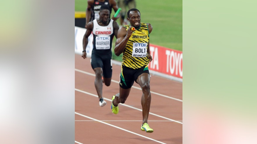 Jamaica's Usain Bolt anchors the team to the gold medal in the men's 4x100m relay at the World Athletics Championships at the Bird's Nest stadium in Beijing, Saturday, Aug. 29, 2015. (AP Photo/Darron Cummings)