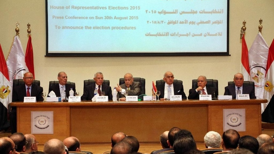 The Supreme Election Committee meets to announce the dates for Egypt's parliamentary elections at a news conference in Cairo, Egypt, Sunday, Aug. 30, 2015. Ayman Abbas, center, head of the Supreme Election Committee, announced that long-awaited parliamentary elections will take place in two stages in October and November. Egypt has been without a legislature for three years. In its absence, President Abdel-Fattah el-Sissi holds legislative authority. (AP Photo/Ahmed Gamil)