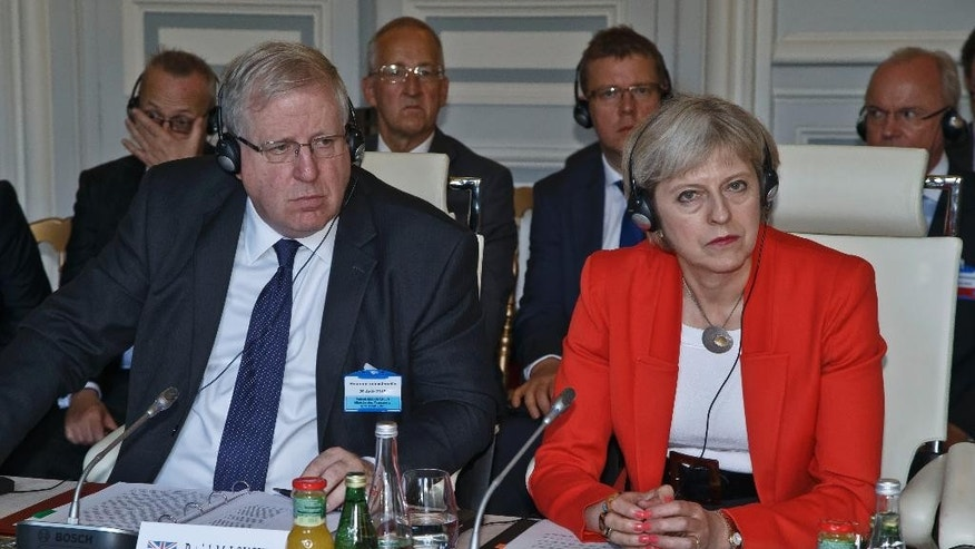 British Transport Secretary Patrick McLoughlin, left, and Home Secretary Theresa May, attend an emergency meeting on train security in Paris, France, Saturday, Aug. 29, 2015. European security and transport chiefs are holding an emergency meeting Saturday in Paris to reconsider train security after passengers thwarted an Islamic extremist gun attack aboard trip from Amsterdam to Paris. (AP Photo/Michel Euler)