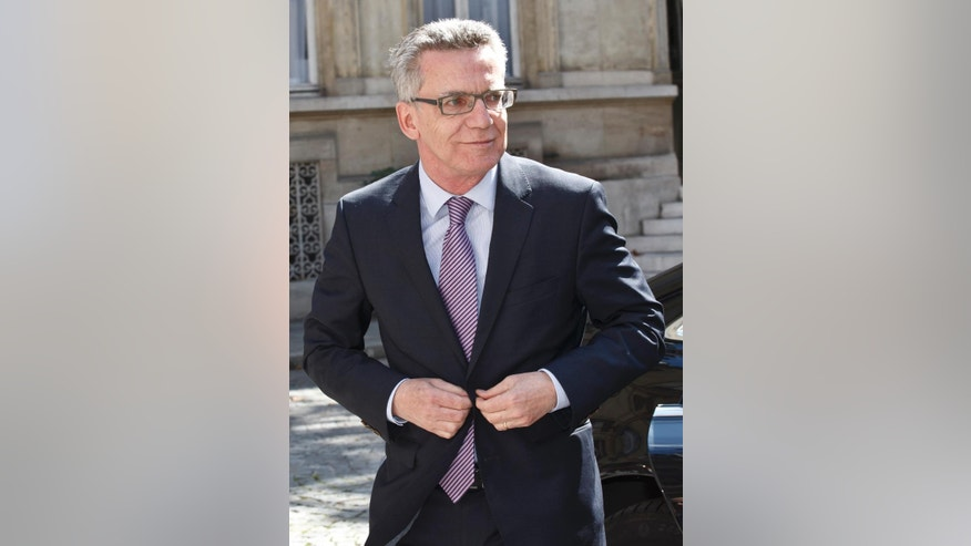 German Interior Minister Thomas de Maiziere arrives for an emergency meeting in Paris, France, Saturday, Aug. 29, 2015. European security and transport chiefs are holding an emergency meeting Saturday in Paris to reconsider train security after American passengers thwarted an Islamic extremist attack on a trip from Amsterdam to Paris. (AP Photo/Michel Euler)
