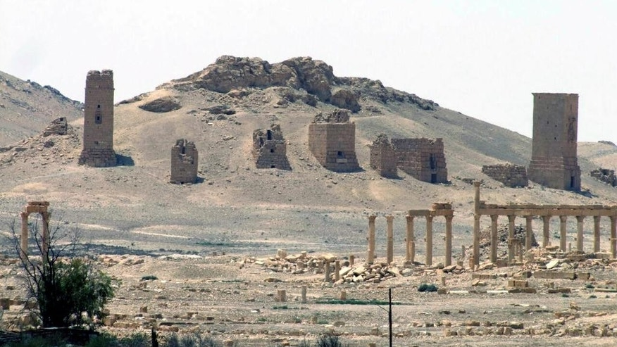 FILE - This file photo released on Sunday, May 17, 2015, by the Syrian official news agency SANA, shows the general view of the ancient Roman city of Palmyra, northeast of Damascus, Syria. Islamic State militants have blown up one of the most important temples in the ancient Syrian city of Palmyra, accelerating their relentless campaign of destruction against the historical treasures that have fallen under their control, activists and monitors said on Sunday, Aug. 30, 2015. (SANA via AP, File)